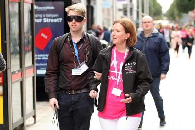 Christopher Leebody in Belfast with the RNIB's Stephanie Holland