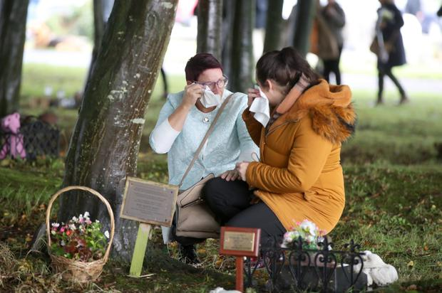 People weeping in Belfast City Cemetery