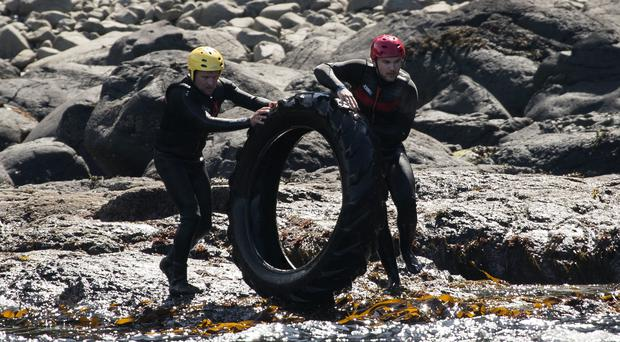 Volunteers help clean up rubbish around the coastline of the Giant's Causeway (Liam McBurney/PA)