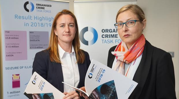 Claire Archbold, right, and PSNI DS Rachel Shields at the launch of the Organised Crime Task Force annual report (Aaron McCracken/PA)