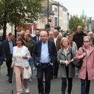 Members from the Wray and McKinney families and supporters walking to Londonderry Magistrates' Court (Liam McBurney/PA)