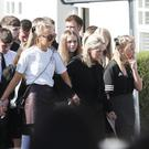 The family joins hundreds of mourners at the funeral of Max Wilson in Rathfriland