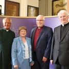 Clockwise from left: Bishop Harold Miller (second right) and his wife Liz with Dean Henry Hull and Bishop Noel Treanor