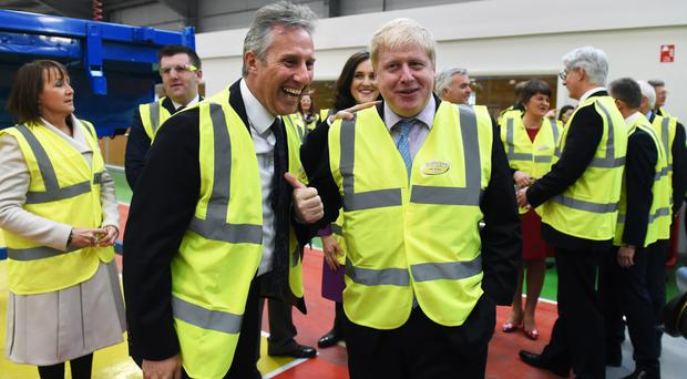 DUP MP Ian Paisley with Boris Johnson at Wrightbus factory in 2016