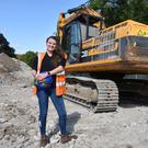 Carrie Murray with the JCB heavy machinery she handles every day