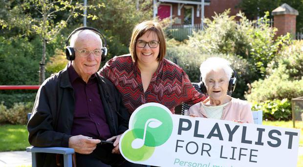 Sally Campton, centre, with Gordon McMullan and Josephine Jones, residents at Palmerston Residential Care Home in East Belfast (Darren Kidd/Presseye/PA)