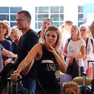 British passengers with Thomas Cook wait at Antalya airport in Turkey yesterday