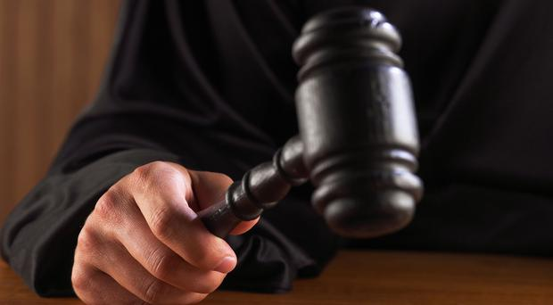 Prosecutors claimed the 28-year-old defendant also slapped and verbally abused the woman (stock photo)