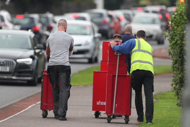 Metal cases for tools are wheeled from the Wrightbus plant in Ballymena (Liam McBurney/PA)