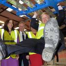 Boris Johnson visits Wrightbus in 2016, watched by then Secretary of State Theresa Villiers, DUP MP Ian Paisley and then First Minister Arlene Foster