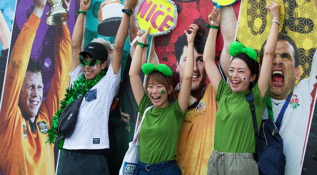 Japanese fans show their support for Ireland ahead of the game in Yokohama