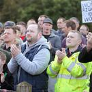 Some of the Wrightbus staff who protested outside Green Pastures Church yesterday