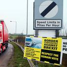 A lorry passes a placard at the border crossing near Dundalk, protesting against potential post-Brexit border checks