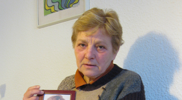Inga Maria Hauser's mum Almut with a picture of her beloved daughter
