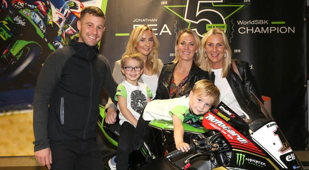 Five-time World Superbike champion Jonathan Rea is greeted by his wife Tatia and sons Jake and Tyler, sister Chloe and mum Claire