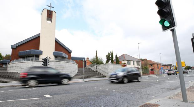 Andersonstown Road in west Belfast where two boys aged six and 12 were knocked down and injured on Saturday