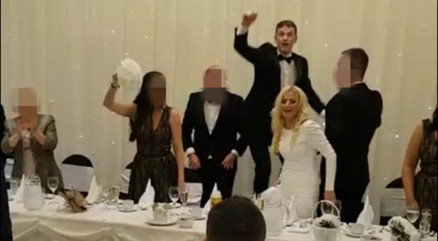 Images from the video showing the newlyweds, and guests, singing the song at the Loughshore Hotel in Carrickfergus