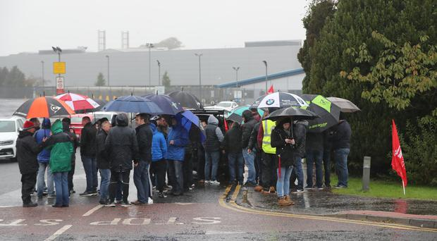 Staff and trade unionists outside the Wrightbus plant in Ballymena (Niall Carson/PA)