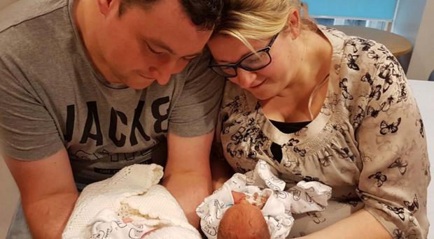John and Claire Haire with their twin sons Charlie, who was stillborn, and Bobby who survived