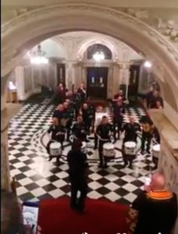 The Govan Protestant Boys band marches through Belfast City Hall