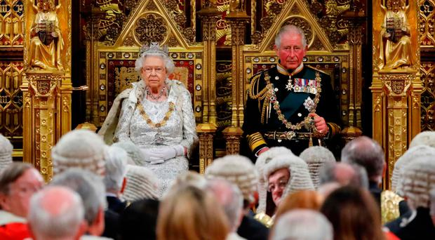 The Queen and Prince Charles before the reading of the Queen's Speech yesterday