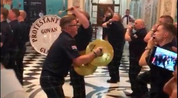 Images of the flute band inside Belfast City Hall