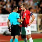 England skipper Harry Kane and referee Ivan Bebek