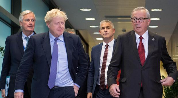 (left to right) Michel Barnier, the EU's Chief Brexit Negotiator, Prime Minister Boris Johnson, Brexit Secretary Stephen Barclay and Jean-Claude Juncker, President of the European Commission (Stefan Rousseau/PA)