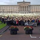 Thousands of people stage a silent demonstration at Stormont over the planned liberalisation of abortion laws in Northern Ireland (Rebecca Black/PA)