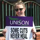 An NHS worker outside the Mater Hospital during a 2017 rally