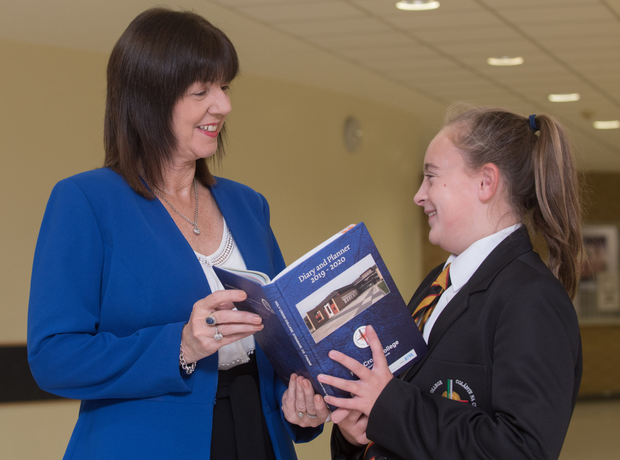 Holy Cross College principal Clare Bradley with Year 8 pupil Macara Kelly