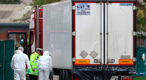 Police forensics officers at the Waterglade Industrial Park in Grays, Essex, after 39 bodies were found inside a lorry on the industrial estate
