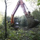 Diggers move in to clear an area in Benburb in the search for Charlotte Murray
