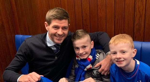 Oliver Dickey (middle) with brother Max and Rangers boss Steven Gerrard