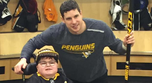 Ballymena lad Ethan McClean with the Pittsburgh Penguins ice hockey team captain Sidney Crosby