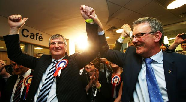 The UUP's Tom Elliott, left, won the Fermanagh South Tyrone Westminster seat in 2015 following a unionist pact (PA)
