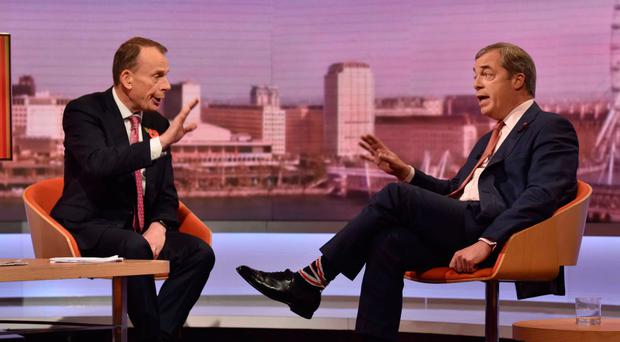 Brexit Party leader Nigel Farage (right) is interviewed on the BBC political programme The Andrew Marr Show yesterday