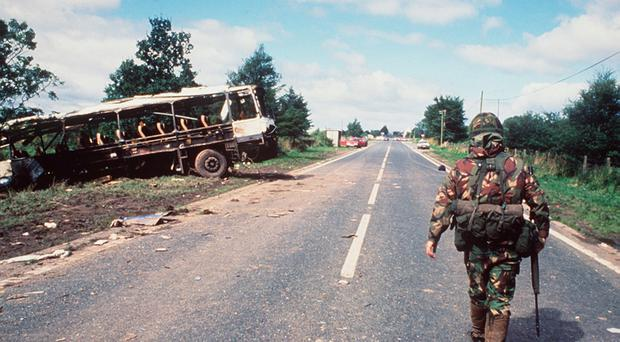 A serviceman surveys the scene of the Ballygawley bombing in which Dave Hardy was injured