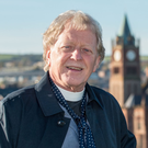 Rev David Latimer stands on the Peace Bridge in Derry