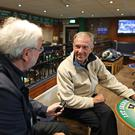 Ivan Little meets fan Tommy Anderson at the Northern Ireland Supporters' Club on the Shankill Road in Belfast