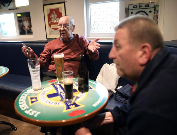 Ivan Little meets fans Eddie Harrison (left) and Campbell Bickerstaff at the Northern Ireland Supporters' Club on the Shankill Road in Belfast
