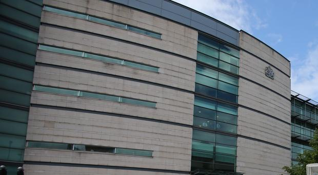 The accused was granted bail at Belfast Magistrates' Court (Niall Carson/PA)
