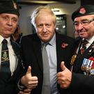 Prime Minister Boris Johnson meets with military veterans at the Lych Gate Tavern in Wolverhampton (Stefan Rousseau/PA)