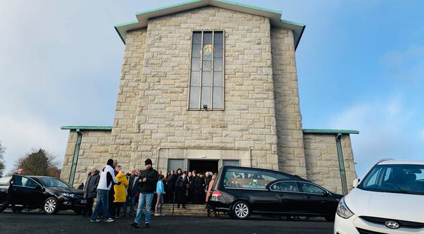 Mourners at St Mary's Church in Creggan, Londonderry, for the funeral yesterday of James Brolly