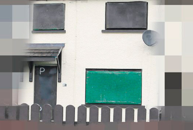 The boarded up home of the Fulton family in Mosside, Co Antrim