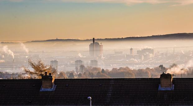 Early morning mist and smoke over a cold Belfast