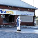 Forensic examination at Carlisles petrol station where the forecourt roof was damaged by a stolen digger
