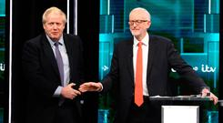 Prime Minister Boris Johnson and Labour leader Jeremy Corbyn shake hands on the set of the debate last night