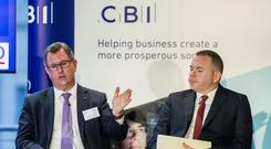 DUP candidate Sir Jeffrey Donaldson (left) and Sinn Fein candidate Chris Hazzard at the CBI NI business election hustings at the Law Society of Northern Ireland (Liam McBurney/PA)