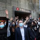 Protesters hold up their hands to symbolise pro-democracy activists' five demands during a demonstration in Hong Kong's financial district